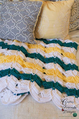 http://www.ravelry.com/patterns/library/diamond-burst-chevron-afghan