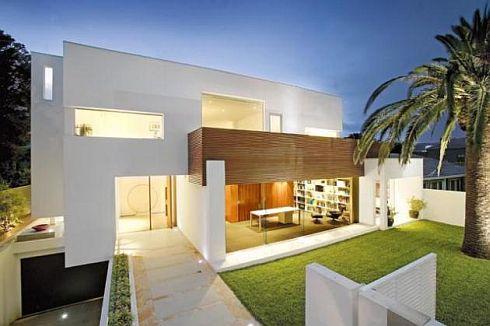 elegante fachada minimalista con cochera en s tano y jardin al frente