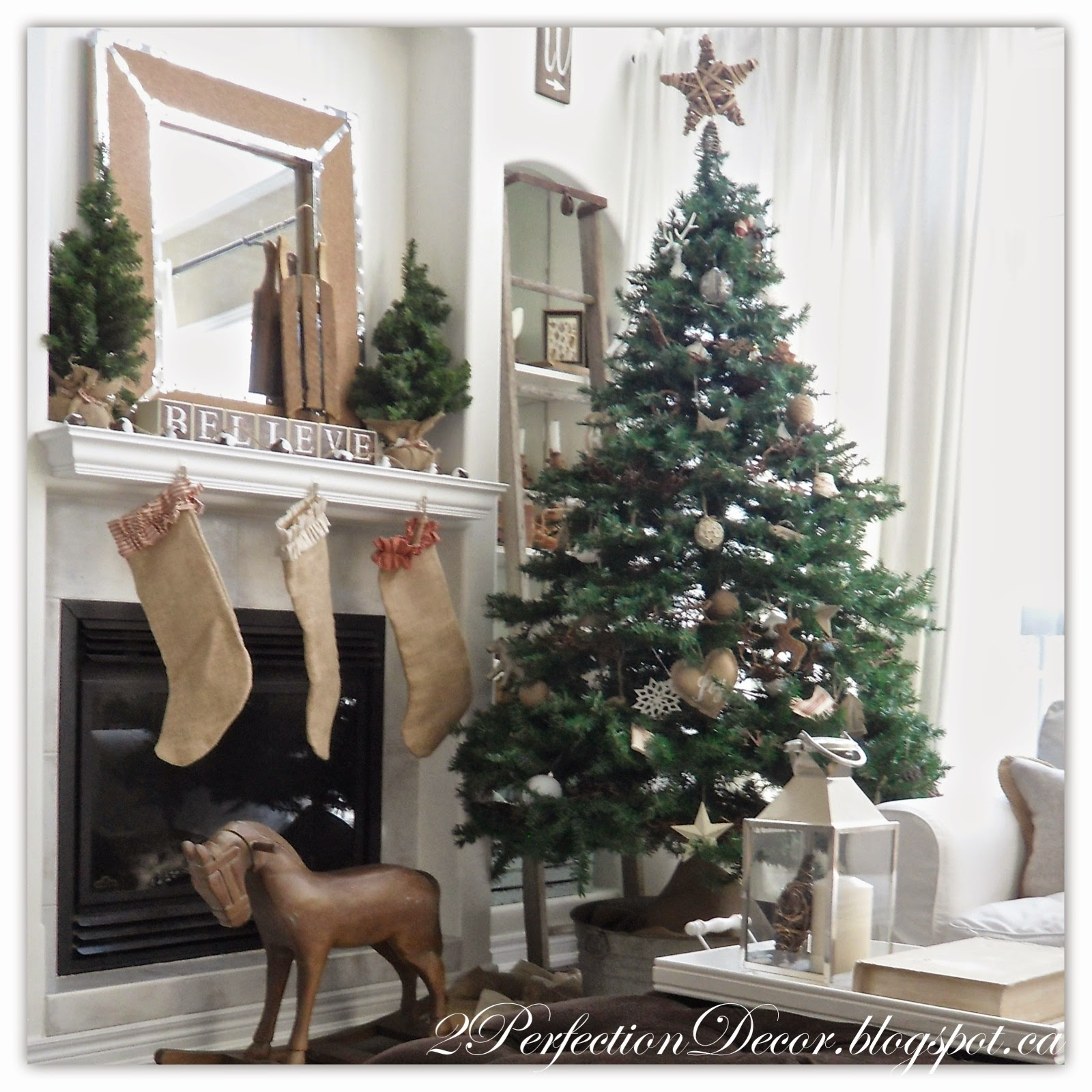 our understated tree features a wooden star vine garland with a mix of new and homemade ornaments mostly made from natural materials like burlap - French Country Christmas Decor