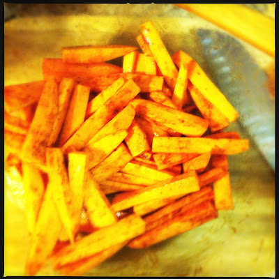covered sweet potato fries ready to bake