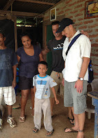 Mark with a family and child doing assessment work in Playa Gigante for Ventura Rotary Club.