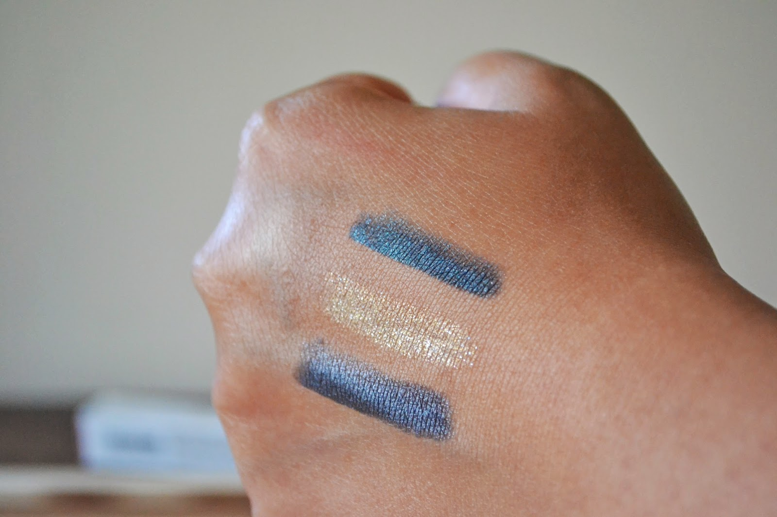 Kiko Milano Color-Up Long Lasting Eyeshadow Pencil Swatches in 28 Persuasive Anthracite, 11 Charming Champagne & 29 Irresistable Teal - Aspiring Londoner