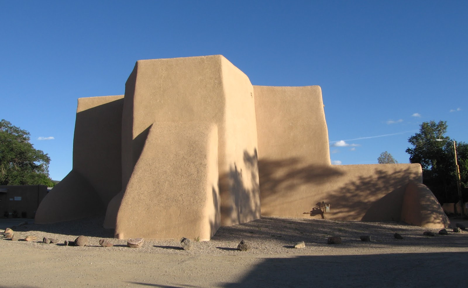 Two graces taos san francisco de asis church ranchos de taos part late in the day around 4pm the shadows from nearby trees fall softly upon the southwest side publicscrutiny Images