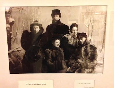 framed picture showed the John D. Rockefeller family visiting the