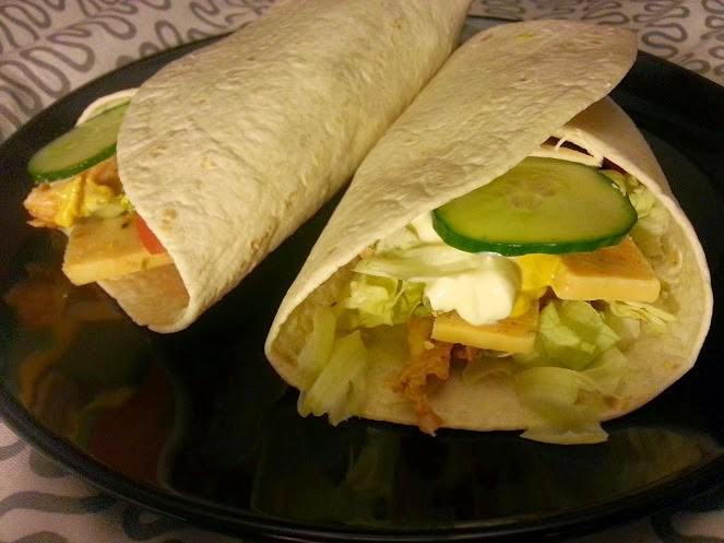 Fajita tacos with cooked meats cheese and salad