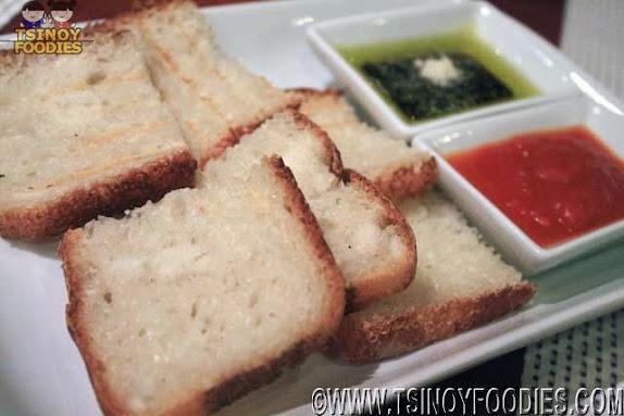 complimentary foccacia bread tomato olive dips