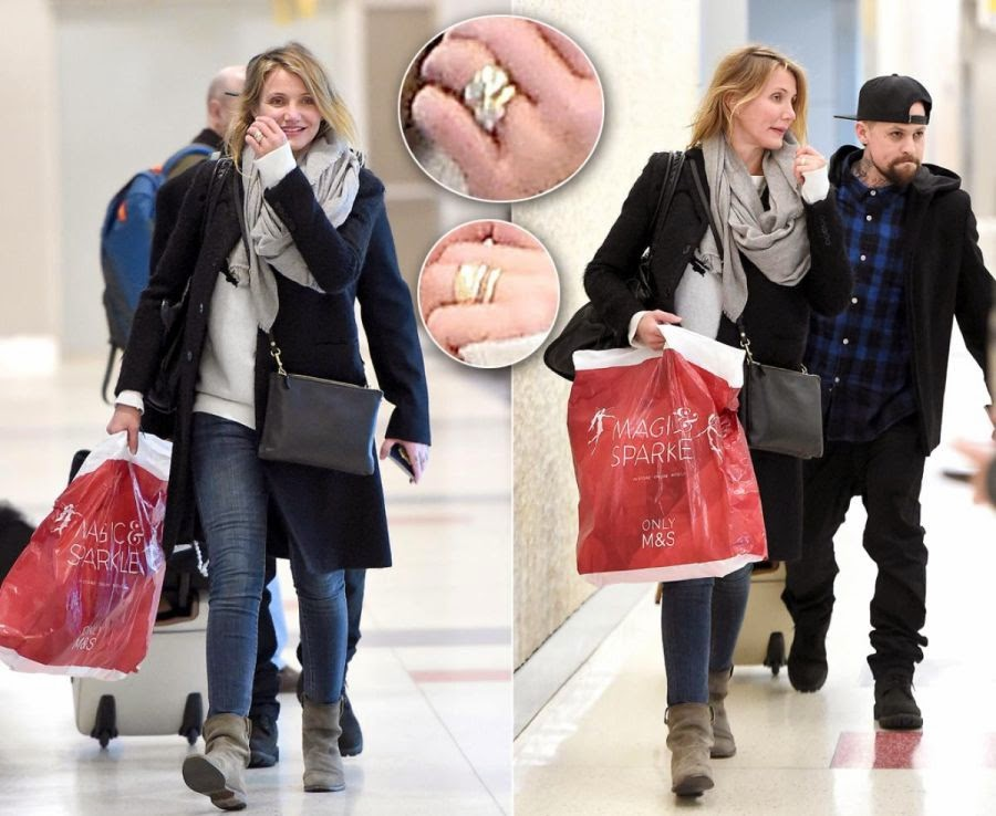 The gorgeous gold rings with the knocking down sphere of jewelry gushed about primafacie as the two was snapped to leaving the JFK Airport at New York, NY, USA on Friday, December 19, 2014.