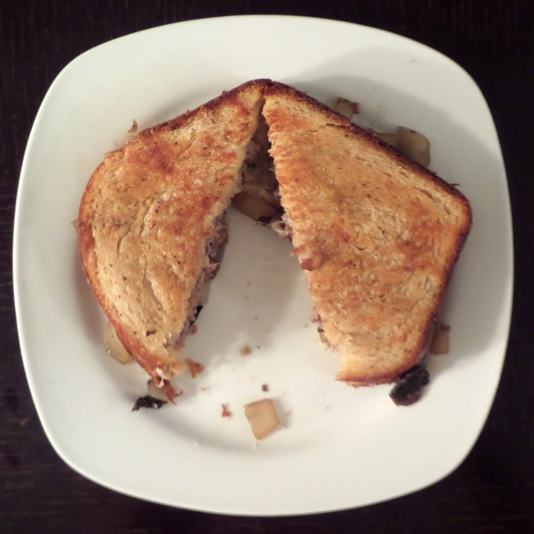 Mushroom and Swiss Patty Melt:  A burger patty, Swiss cheese, and sauteed mushrooms and onions, sandwiched between 2 slices of bread then grilled until hot and melty.