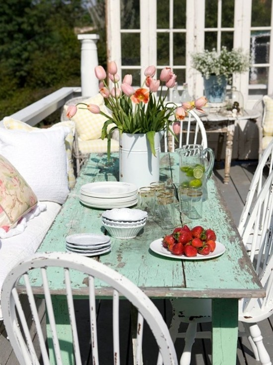 This rustic farmhouse table makes perfect porch decor. Gather friends and family for an outdoor meal