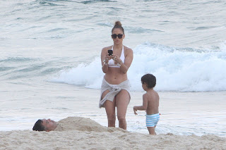 Jennifer Lopez taking photos of her kids  playing in the sand onn a beach in Rio