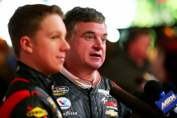NASCAR Camping World Truck Series drivers John Hunter (L) and Joe Nemechek speak to the media during the 2015 NASCAR Media Day at Daytona International Speedway on February 12, 2015 in Daytona Beach, Florida.