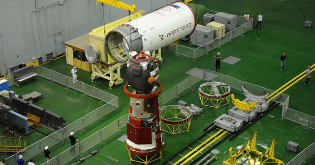 The Progress M-28M spacecraft is seen in its processing facility at the Baikonur Cosmodrome in Kazakhstan being prepared for launch. Photo Credit: Energia.ru
