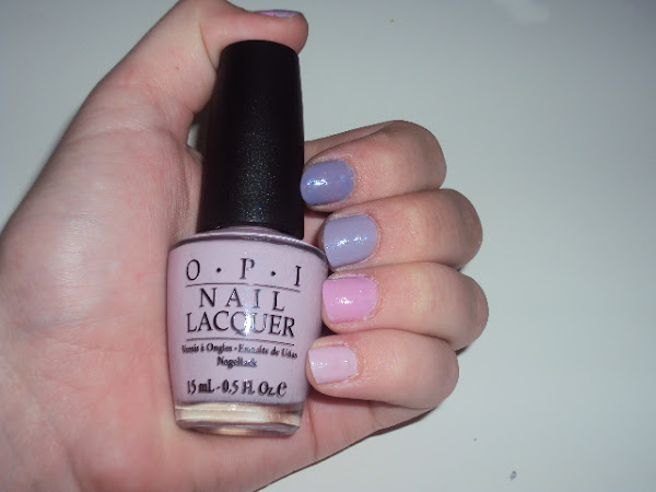 Pink and purple OPI nails.