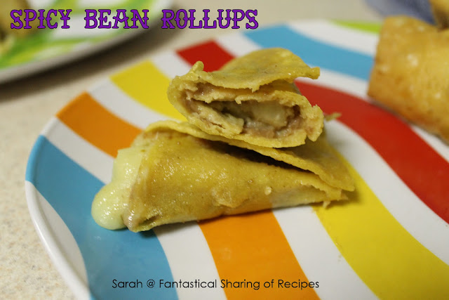 Spicy Bean Rollups - all the key ingredients for a great snack or appetizer rolled into one! #appetizer #cheese #gameday #spicy