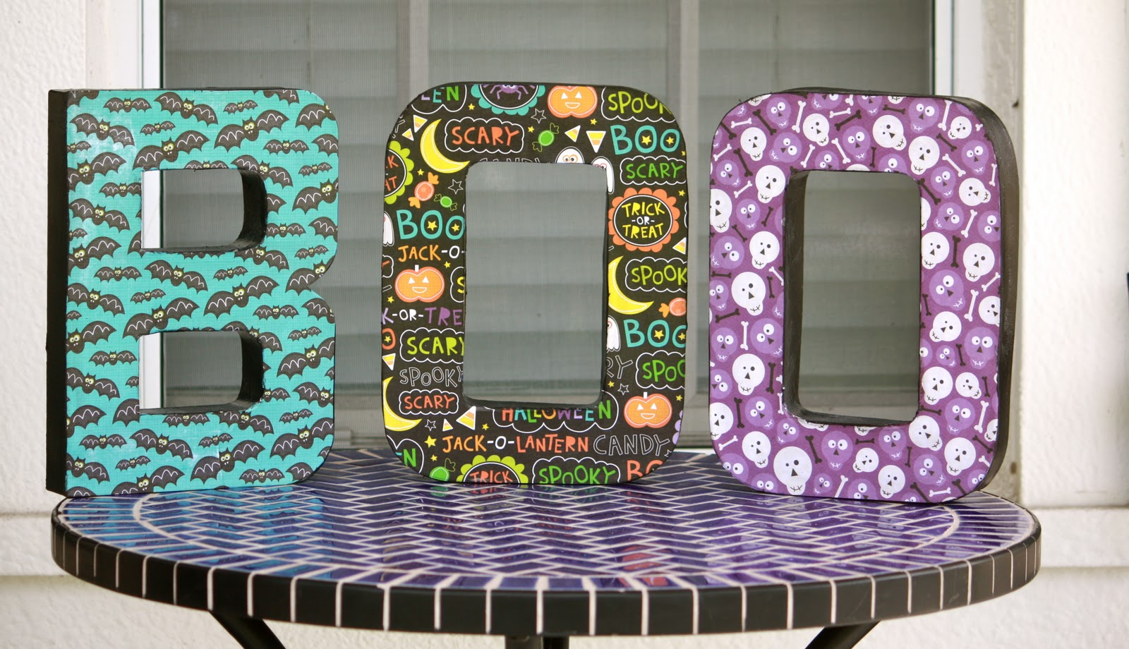 since we love mod podge and we love halloween it only made sense to combine the two decoupage letters are an easy and inexpensive diy decoration