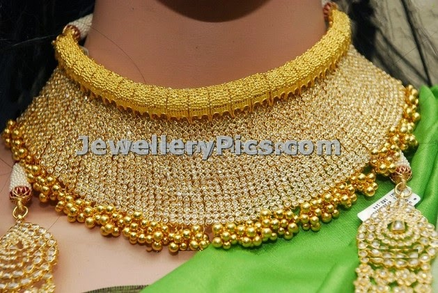 Broad gold uncut diamond choker