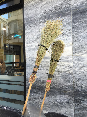 Street cleaning brooms in Ronda, Spain.