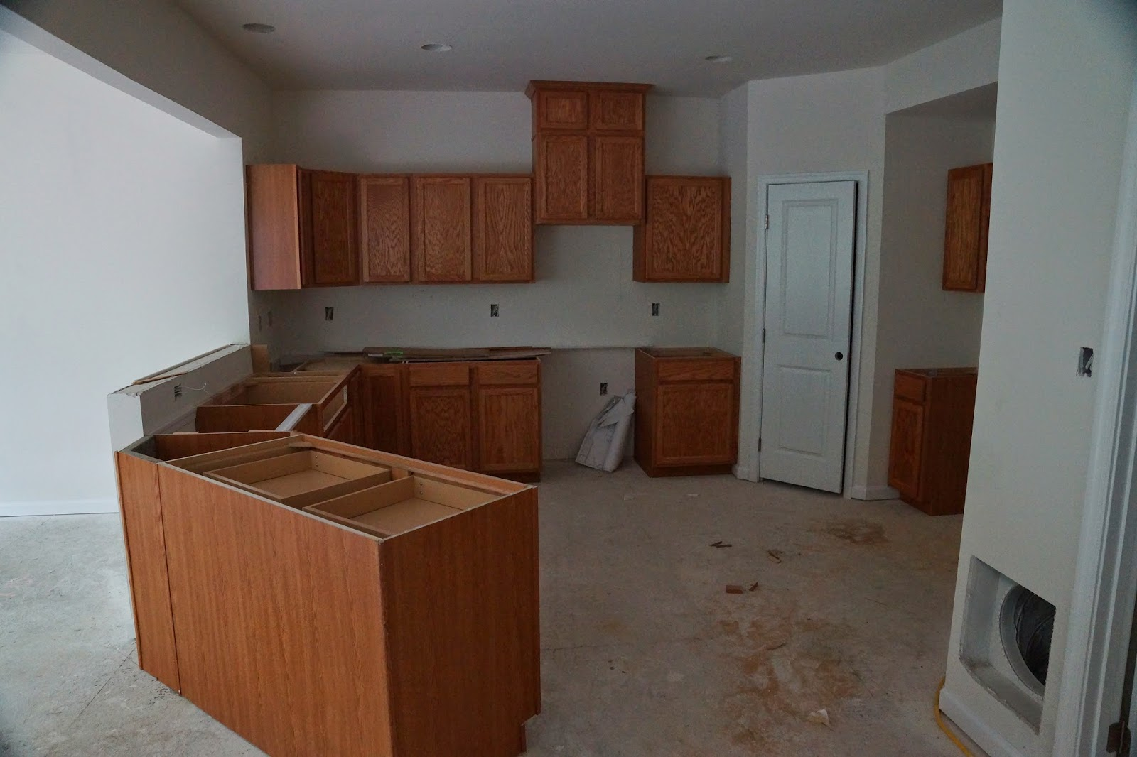 Picture of the kitchen cabinets before the counter is installed as viewed from the family room