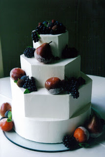 A hexagon sugared fruit wedding cake.