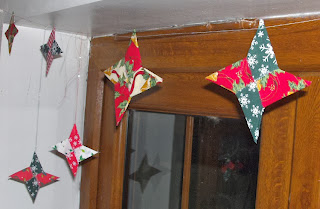 A garland of four-pointed fabric origami stars, made with Christmas prints.