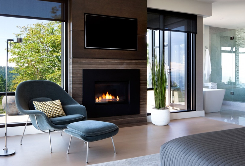 Bedroom fireplace in Elegant modern house in west Vancouver, Canada