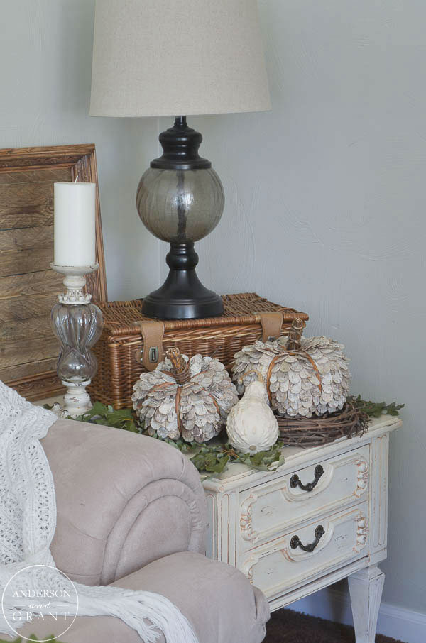 Simple fall pumpkin display on a living room side table.  |  www.andersonandgrant.com