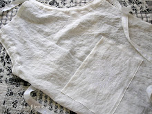 Embroidered white linen apron