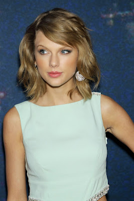 Taylor Swift in light blue dress at SNL 40th Anniversary Celebration Red Carpet