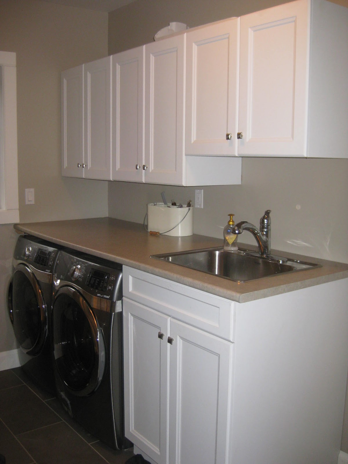 Laundry Room With Folding Station