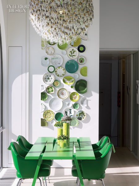 A beautiful selection of green plates on the wall