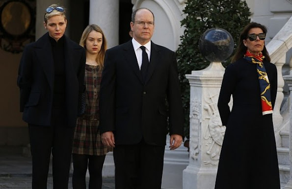 Prince Albert II of Monaco and Princess Charlene of Monaco, Princess Caroline of Hanover and Princess Alexandra observe a minute of silence on November 16, 2015 at the Monaco Palace in Monaco