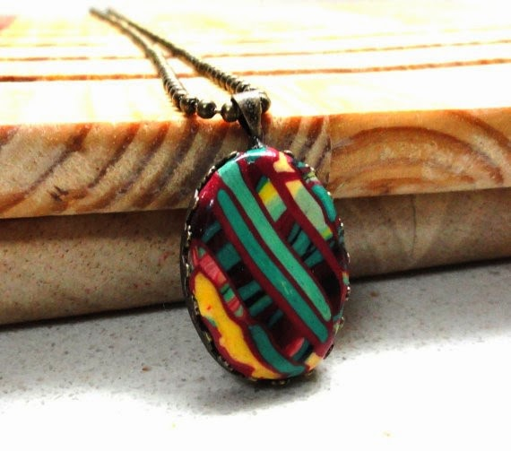 https://www.etsy.com/listing/89957463/handmade-polymer-clay-oval-shape-pendant?ref=shop_home_active_4