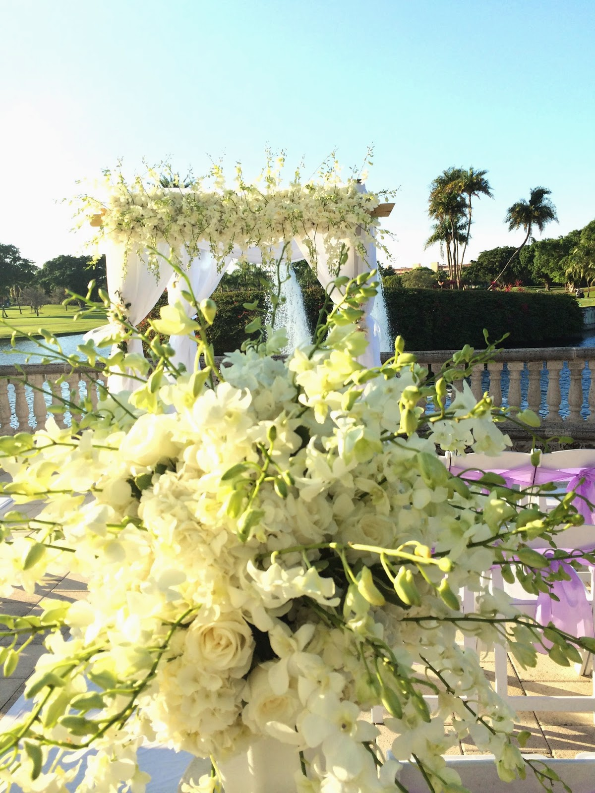 white wedding ceremony arch, wedding flowers, wedding white theme