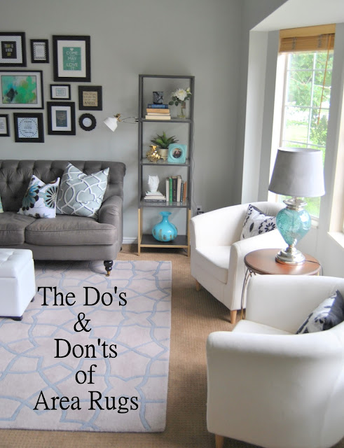 area rug, rug, chair, family room, do's and don'ts, navy rug, family room rug, tan rug, trellis rug, trellis, mantel, gallery wall, living room, white chair, chair, sofa, grey tuft, gray tuft, gray tufted, grey tufted, ikea hack, shelf, book case, aloof gray