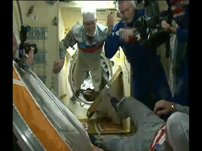 New Expedition 37 Trio Welcomed Aboard Station. Credit: NASA TV