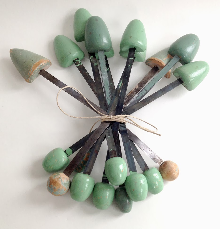 https://www.etsy.com/listing/177861632/1950s-lot-of-10-painted-shoe-trees?ref=shop_home_active_13