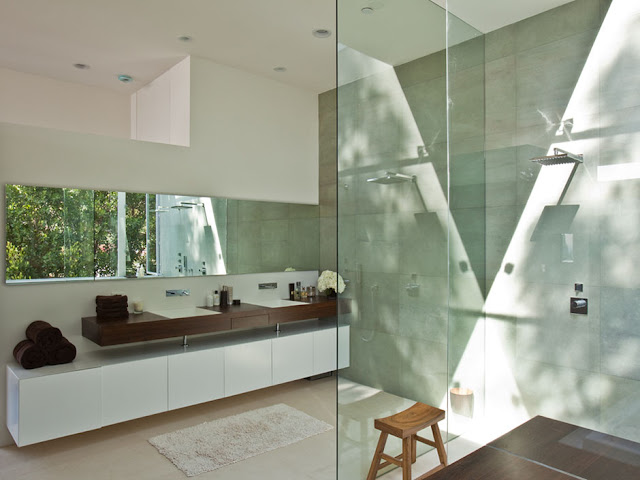 Picture of the beautiful modern bathroom with large shower cabin and large mirror on the wall
