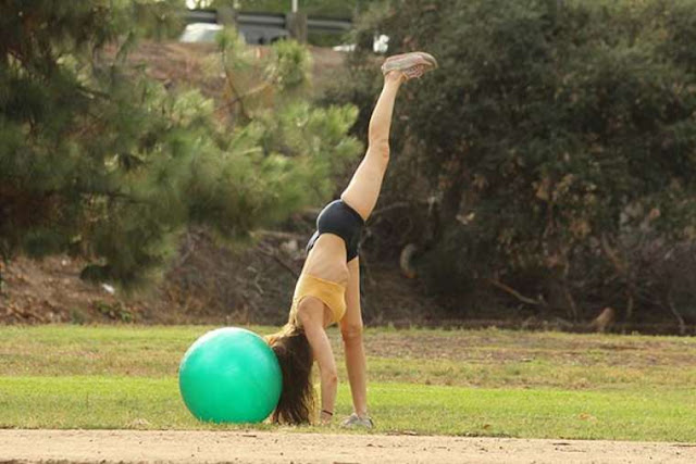 Alicia Arden shows toned curves doing yoga in Valley Village