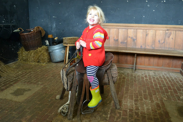 Tin Box Tot sat on a horses saddle in a stable at Mottisfont Abbey