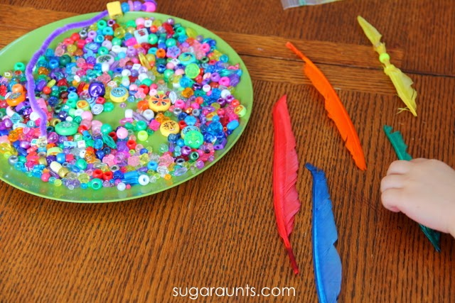 Sorting colored beads to match colored feathers is a fun way to learn colors.