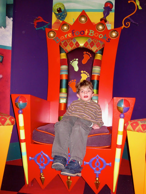 Grandson sitting in chair at Barefoot Books studio