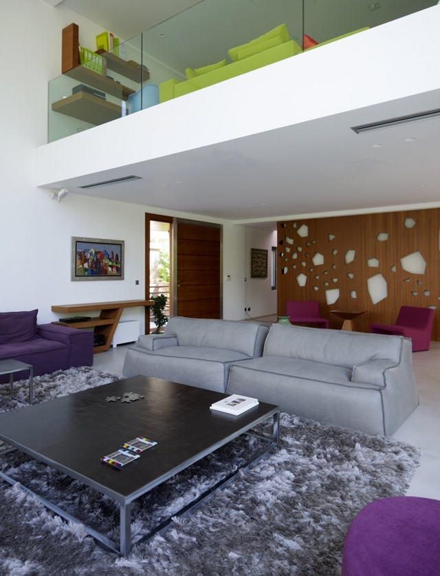 Modern living room with grey and purple furniture