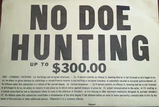 sign that says no doe hunting up to $300 fine with trespass language
