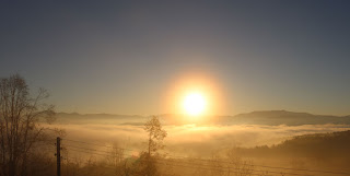 Sun rise over a foggy valley