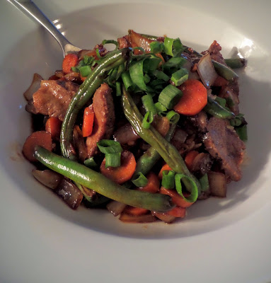 Szechuan Beef  Stir Fry:  A spicy beef stir fry, with bold flavors of ginger and garlic with just a hint of sweetness, made with leftover steak.