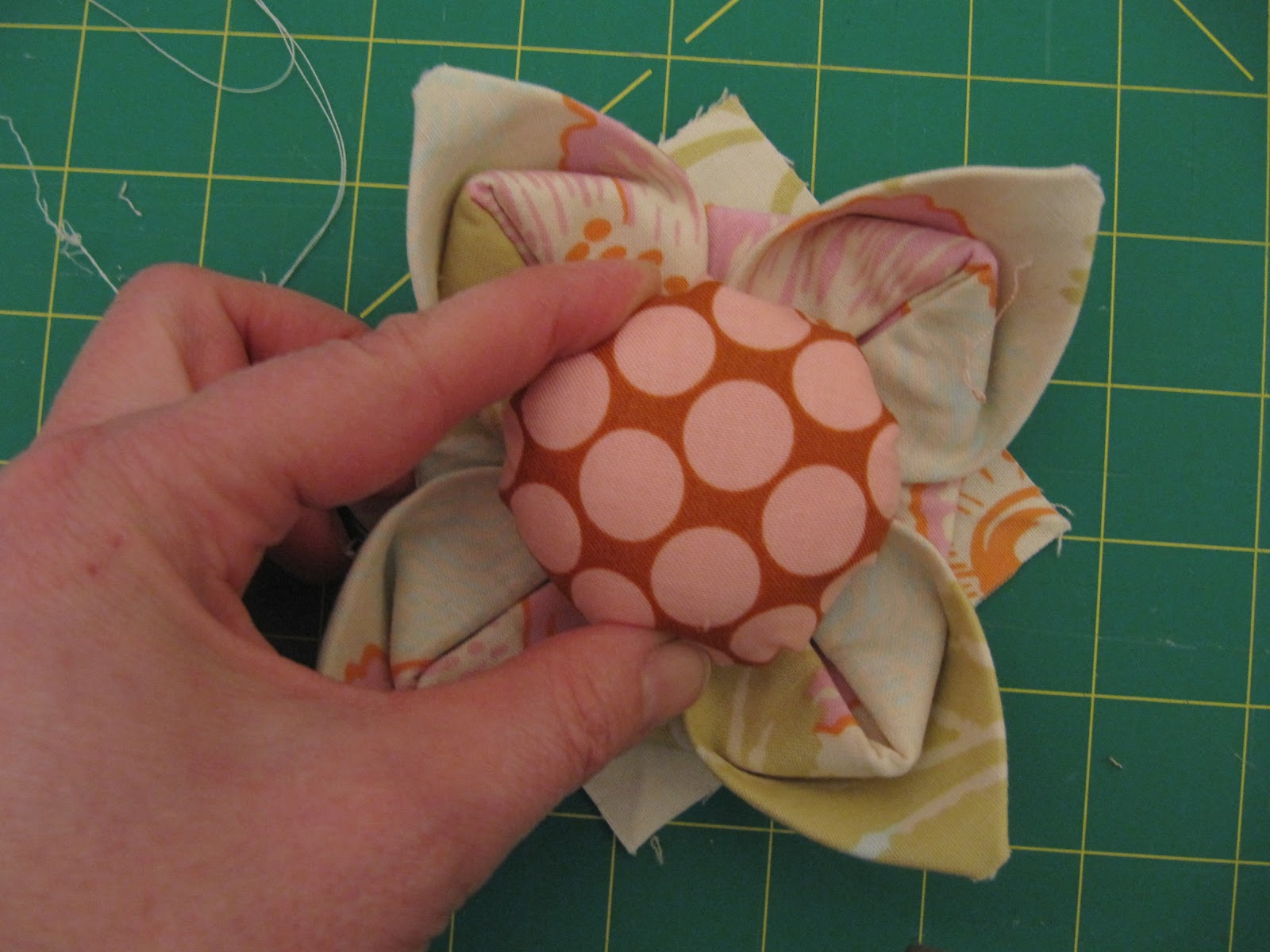 Knotted cotton how to make a fabric origami lotus flower pincushion izmirmasajfo Images