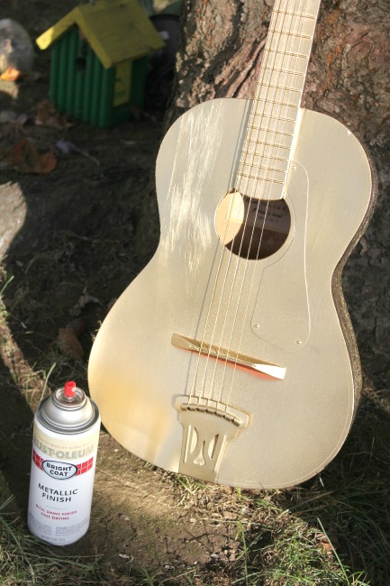 Child's guitar sprayed with metallic gold paint