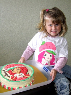 Girl in Strawberry Shortcake T-shirt Birthday Cake