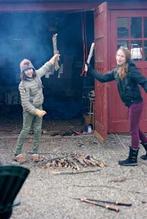 girls playing with sticks