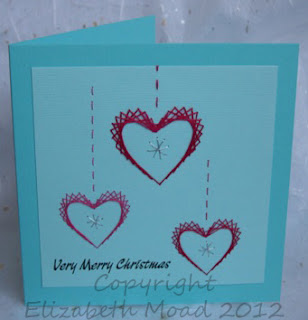 stitched hearts on a card
